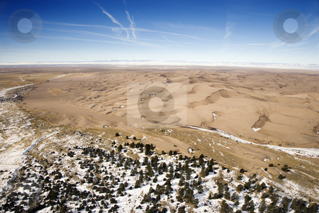 Great Sand Dunes National Park, Colorado. stock photo, Aerial landscape of snowy plains and dunes in Great Sand Dunes National Park, Colorado. by Iofoto Images