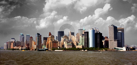 Manhattan Skyline stock photo, View of the Manhattan skyline as seen from the south. In front one can see Battery Park, with the buildings of New York's financial district. by Paul Hakimata