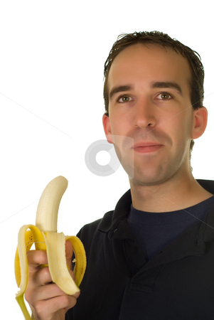 Healthy Snack stock photo, A man enjoying a banana, isolated against a white background by Richard Nelson