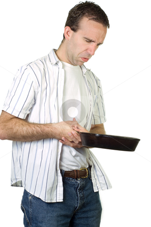 Cooking Disaster stock photo, A man looking at his failed attempt at cooking by Richard Nelson