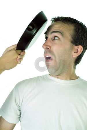 Abuse stock photo, A young man getting abused with a frying pan by Richard Nelson