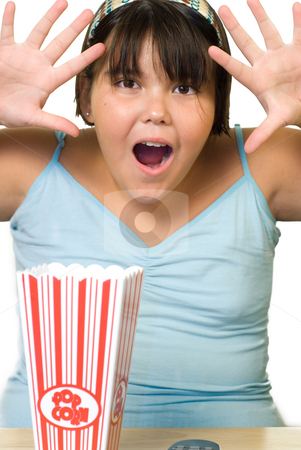 Surprise stock photo, A young girl making a surprised face, pretending her movie is scary by Richard Nelson