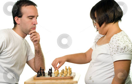 Playing Chess stock photo, A young man and a girl playing a game of chess, isolated against a white background by Richard Nelson
