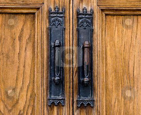Door Handles stock photo, Closeup of two handles on a wooden door by Richard Nelson