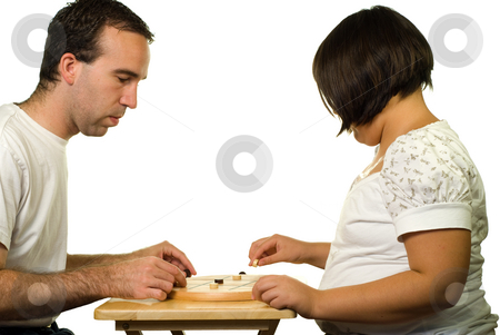 Tic-tac-toe stock photo, Father and daughter playing a game of tic-tac-toe by Richard Nelson