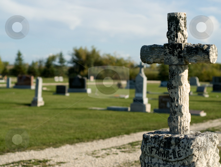 Graveyard stock photo, A rural graveyard or cemetery shot during the day by Richard Nelson