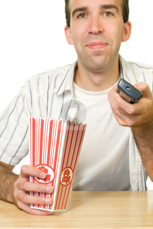 Watching Television stock photo, A man using the remote control to change channels by Richard Nelson