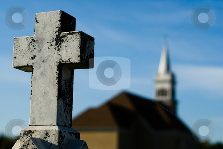 Religious Crucifix stock photo, Shallow depth of field view of a crucifix with a church in the background by Richard Nelson