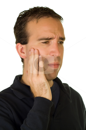 Toothache stock photo, A young caucasian man holding his mouth in pain by Richard Nelson