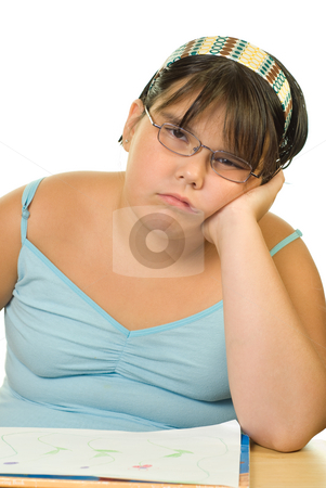 Boring Homework stock photo, A young girl looking bored at having to do homework by Richard Nelson