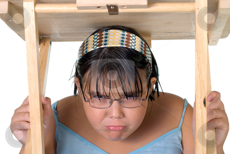 Girl Hiding Under Table stock photo, A young caucasian girl hiding under a table, isolated against a white background by Richard Nelson
