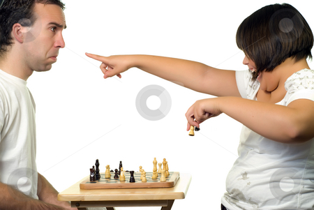 Girl Bragging stock photo, A young girl bragging that she's winning a chess game by Richard Nelson