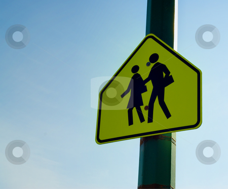 School Crossing stock photo, A school crossing sign shot against blue sky by Richard Nelson