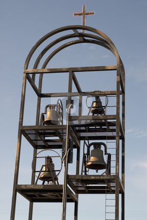 Church Bells stock photo, Four large church bells shot against the blue sky by Richard Nelson