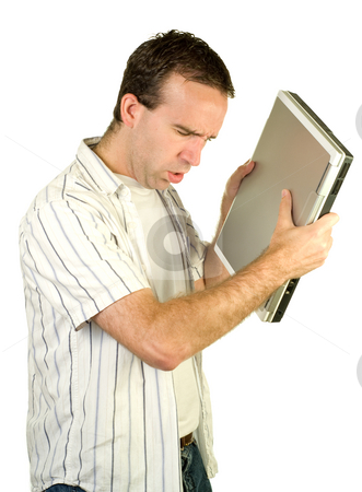 Computer Frustration stock photo, A young man about to smash his laptop into the ground, isolated against a white background by Richard Nelson