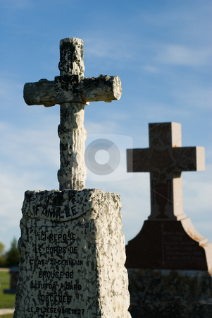Crucifix stock photo, Two graves with crosses on top, shot against a blue sky by Richard Nelson