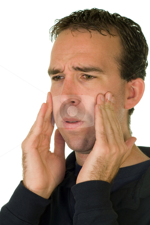 Pulled Wisdom Teeth stock photo, A man feeling his cheeks where his wisdom teeth used to be by Richard Nelson