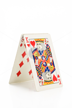 House of cards. stock photo, House made of cards, on white background. by Pablo Caridad
