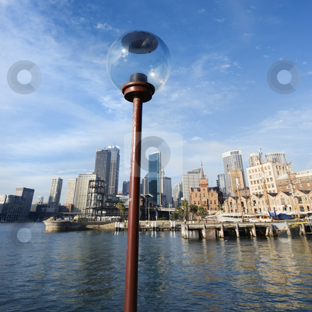 Sydney Cove, Australia. stock photo, Lamppost in  Sydney Cove with city skyline and water in Sydney, Australia. by Iofoto Images
