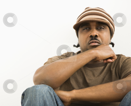 Man wearing knit cap. stock photo, African-American mid-adult man wearing hat looking at viewer. by Iofoto Images