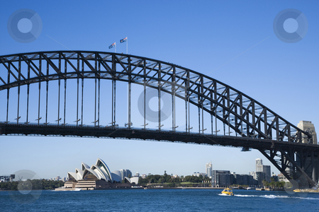 Bridge, Sydney Australia. stock photo, Sydney Harbour Bridge with view of downtown buildings and Sydney Opera House in Australia. by Iofoto Images