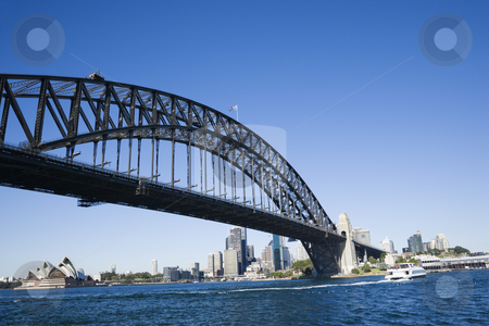 Sydney Harbour Bridge. stock photo, Sydney Harbour Bridge with view of downtown buildings and Sydney Opera House in Australia. by Iofoto Images