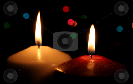 Two Christmas Candles stock photo, A closeup of red and white Christmas candles. by Chris Hill