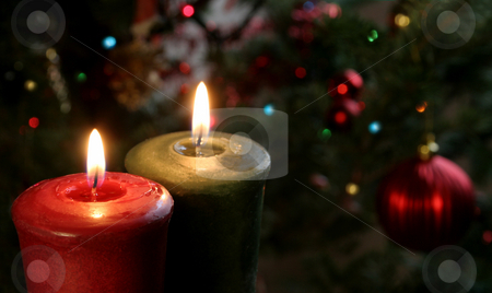Two Christmas Candles stock photo, Christmas candles set against a tree. by Chris Hill