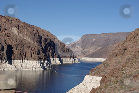 Hoover Dam's Lake Mead stock photo, Lake Mead, the man made lake created by the Hoover Dam in 1935 and source of water for 22 million people in the Southwest, could go dry by 2022 acording to Tim Barnett, a research marine geophysicist with the Schipps Institution of Oceanography.  The lake is down 100 feet due to a 20-year drought as shown by the white areas on the surrounding landscape above the dam on the Colorado River (photo February 17, 2008). by Dennis Thomsen