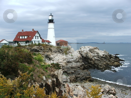 Portland Head Light, Cape Elizabeth, ME stock photo, Maine's Oldest Lighthouse- This much photographed lighthouse at Cape Elizabeth, Me is a top tourist destination for travelers to Portland. Portland Head Light is the oldest lighthouse in Maine. Construction began in 1787 and the Atlantic seaboard lighthouse went operational in 1791. Over a million people reportedly visit this lighthouse yearly (Photo 10/10/2007). by Dennis Thomsen