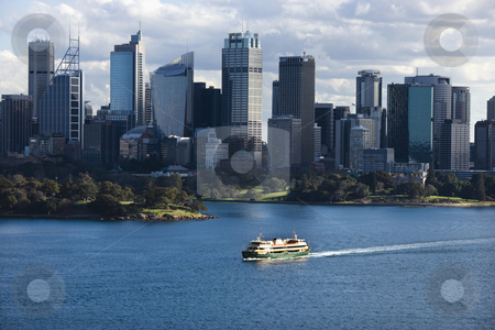Sydney, Australia skyline. stock photo, Aerial view ferryboat crossing harbour with skyline of  Sydney, Australia. by Iofoto Images