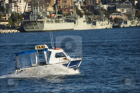 Water taxi, Australia. stock photo, Water taxi and view of buildings and boats in Sydney, Australia. by Iofoto Images