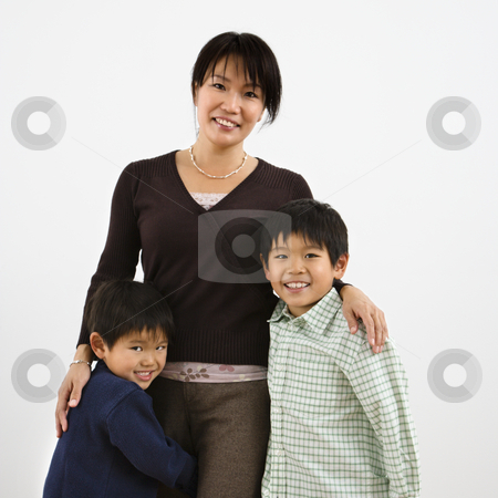 Mother and children stock photo, Portrait of Asian mother with two young sons. by Iofoto Images