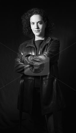 Serious woman portrait. stock photo, Woman in leather jacket with arms crossed looking at viewer. by Iofoto Images