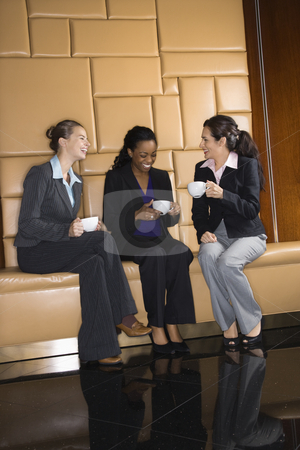 Businesswomen with coffee. stock photo, Businesswomen drinking coffee and conversing. by Iofoto Images