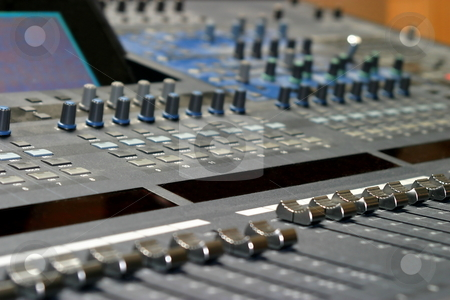 Mixing Console stock photo, Top view of a mixing console in a music studio by Henrik Lehnerer