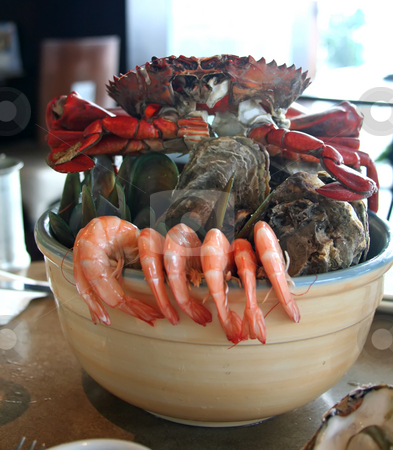 Seafood on ice stock photo, Seafood on ice served in a restaurant with prawns crabs and shellfish by Kheng Guan Toh