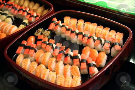 Sushi arrangement stock photo, Arrangement of sushi and sashimi in a restaurant setting by Kheng Guan Toh