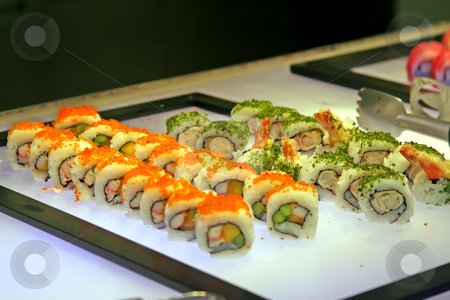Sushi buffet stock photo, Restaurant sushi buffet with rows of japanese sushi by Kheng Guan Toh