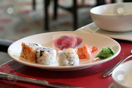 Sashimi sushi stock photo, Arrangement of sushi and sashimi in a restaurant setting by Kheng Guan Toh