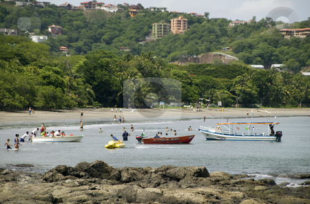 Playa hermosa in Costa Rica stock photo, People and boats in the water at Playa Hermosa Costa Rica by Scott Griessel