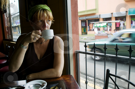 Coffee in Costa Rica stock photo, Woman drinks coffee in an Alejuela Costa Rica cafe by Scott Griessel