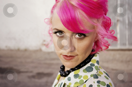 Woman with Pink Hair stock photo, Woman with pink hair in an alley by Scott Griessel