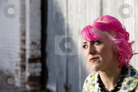 Woman in an Alley stock photo, Woman with pink hair in an urban alley by Scott Griessel