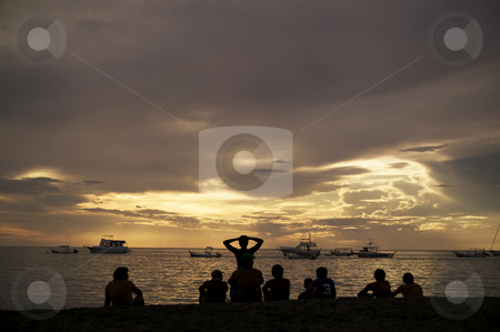Silhouettes at Sunset in Costa Rica stock photo, Costa Rica sunset with Boats and silhouettes of people on beach by Scott Griessel