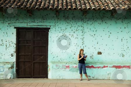 American Tourist in Granada Nicaragua stock photo, Female American Tourist with a Guide Book in Granada Nicaragua by Scott Griessel