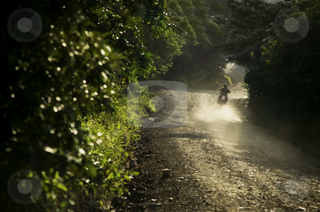 Motorcycle in Costa Rica stock photo, Motorcycle on a dirt road at dusk in Santa Elena Costa Rica by Scott Griessel