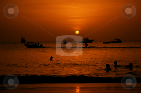 Swimmers and Water Skier at Sunset stock photo, Swimmers and water skier in the Pacific Ocean at sunset by Scott Griessel