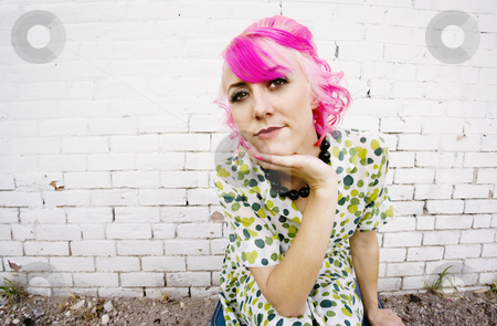 Woman with Pink Hair  stock photo, Woman with pink hair wearing polka dot dress in alley by Scott Griessel