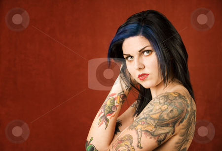 Woman with tattoos stock photo, Pretty young woman with many colorful tattoos by Scott Griessel
